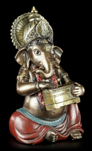 Small Ganesha Figurine playing Harmonium