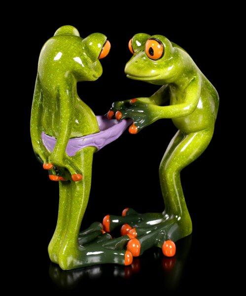 Lustige Frosch Figuren beim Hosencheck