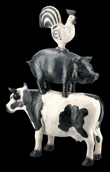 Hahn auf Schwein auf Kuh Figur