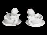 Two white Cherubim Figurines in Tea Cups