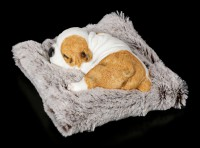 Dog Figurine asleep on grey Blanket