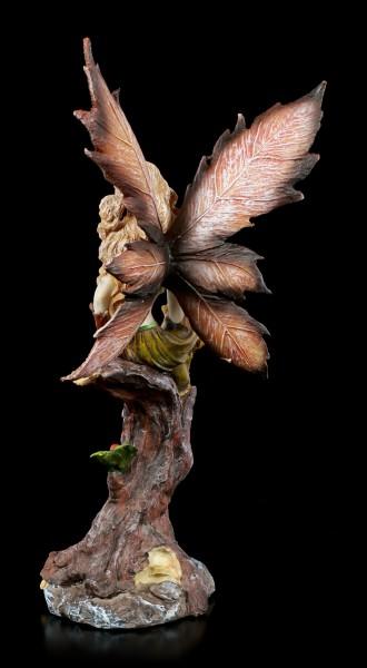 Elf Figurine - Silva sits on Tree Stump