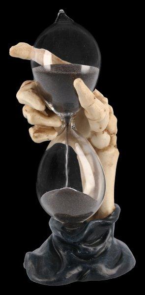 Skeletthand Sanduhr mit schwarzem Sand