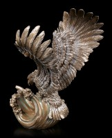 Eagle Figurine catches Fish out of the Water
