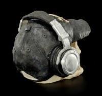 Totenkopf mit Cappie und Kopfhörern