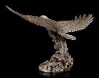 Große Adler Figur fängt Fisch