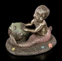 Meerjunge Figur mit Kugelfisch