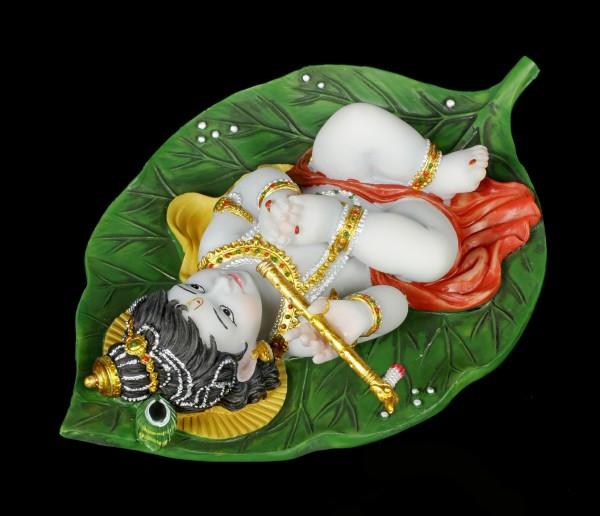 Baby Krishna Figur auf Buddhabaum Blatt