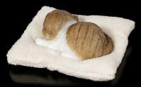 Cat Figurine asleep on white Blanket