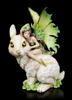 Elfen Figur reitet auf Hase
