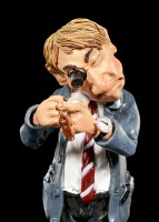 Watchmaker Figurine with magnifying Glass