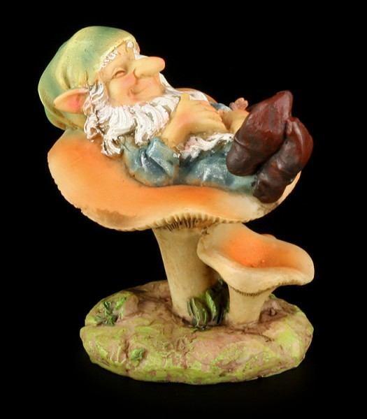 Garten Figur - Zwerg liegt auf Pilz