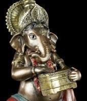 Kleine Ganesha Figur musizierend mit Harmonium
