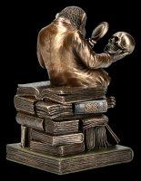 Affe mit Schädel - Darwinismus Evolutionstheorie