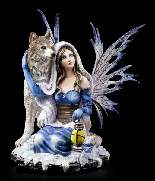 Fairy Figurine kneels with Wolf