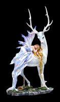 Fairy Figurine sleeping on a white Stag