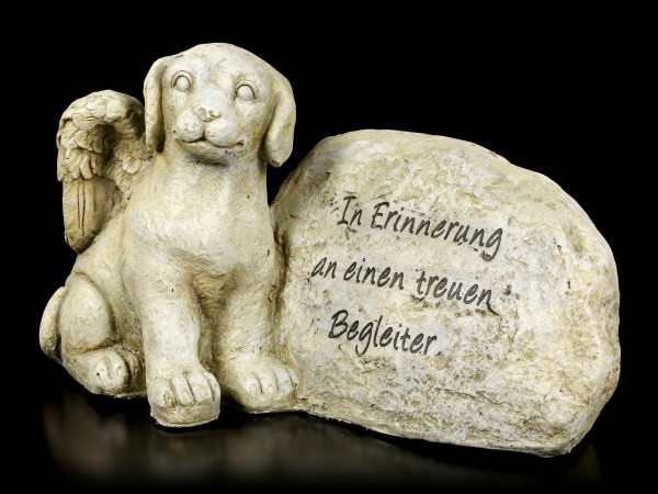 Dog Angel Figurine next to Tombstone