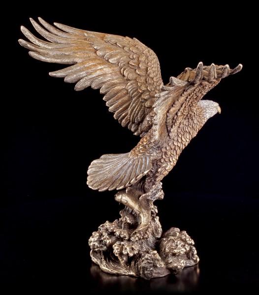 Bald Eagle Figurine catches Fish