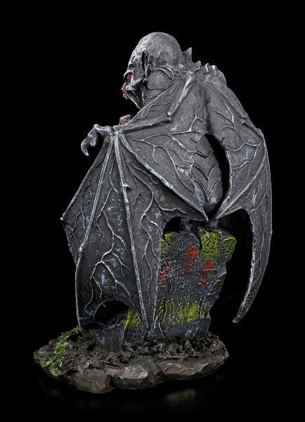 Vampir Figur auf Grabstein