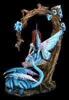 Fairy Figurine on Swing with blue Dragon