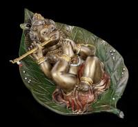 Baby Krishna Figur auf Buddhabaum Blatt - bronziert