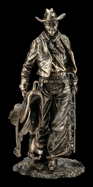 Standing Cowboy Figurine with Saddle and Gun
