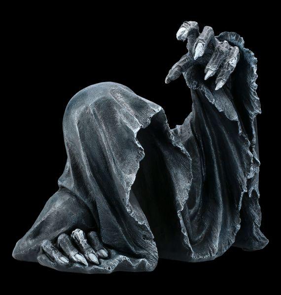 Grim Reaper Figur steigt aus Grab