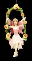 Pink Fairy Figurine on Swing