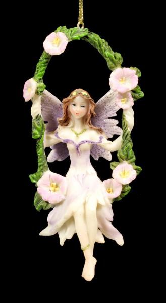 Lila Elfen Figur auf Schaukel