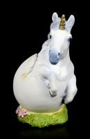 Einhorn Figur befreit sich aus Ei