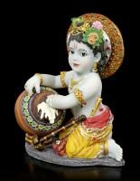 Baby Krishna Figurine steals Butter