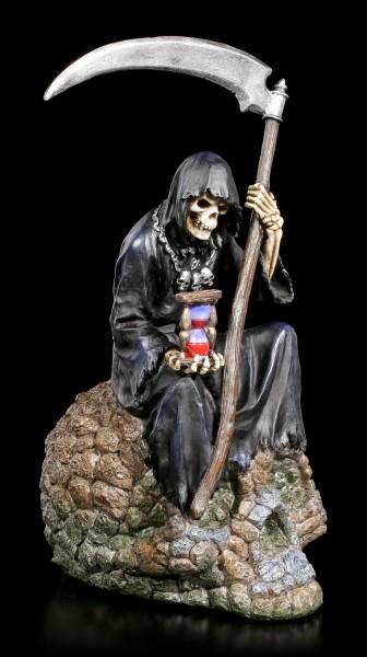 Grim Reaper Figur - Sitzt auf versteinertem Schädel