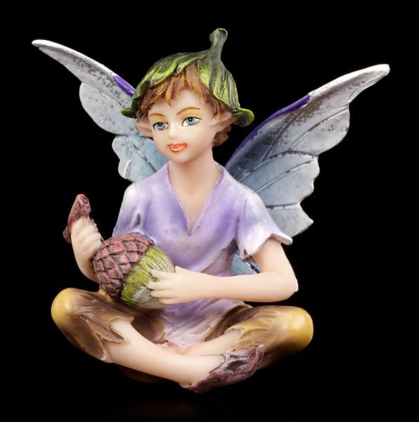 Kleine Elfen Figur - Junge sitzend