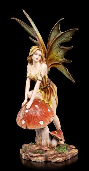 Fairy Figurine - Seraphine climbs on Mushroom