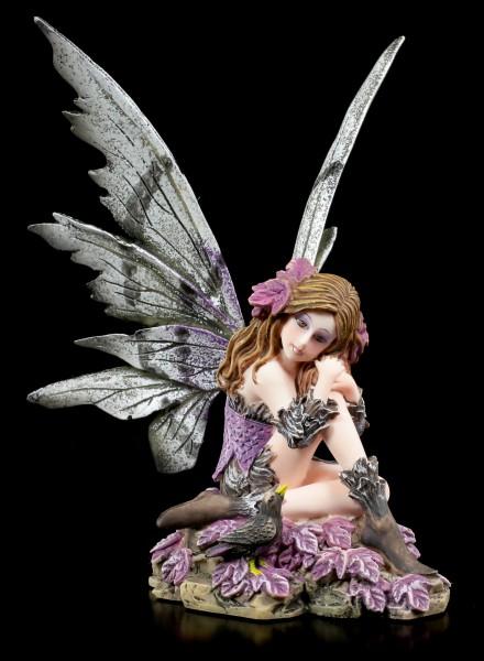 Feen Figur sitzend auf Blumen - Fairy Land