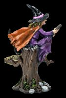 Witch Figurine Riding on a Broom with a Cat