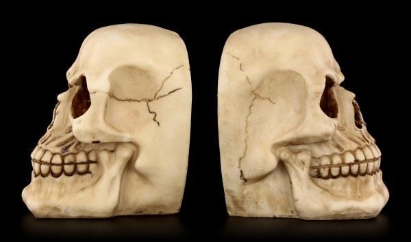 Buchstützen - Zwei menschliche Totenköpfe