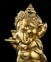 Ganesha Figur mit Flöte - goldfarben