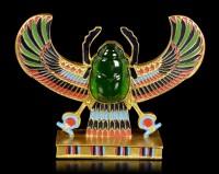 Geflügelter Skarabäus mit grünem Stein
