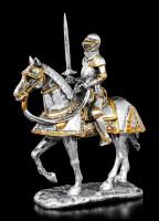 Kleine Ritter Figur mit erhobenem Schwert auf Pferd