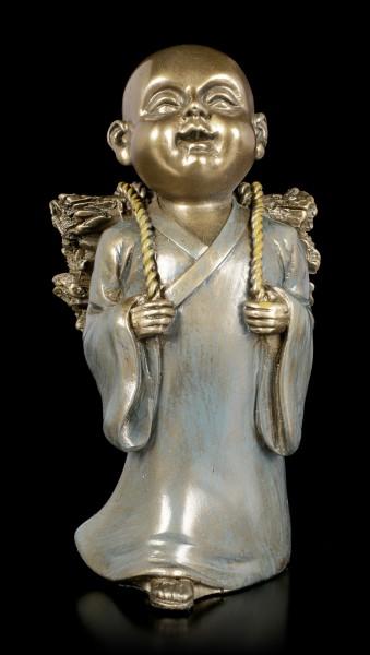 Monk Figurine with Wood on Back