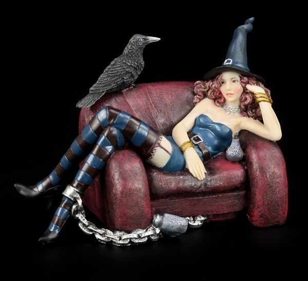 Witch Figurine with Raven Sitting on Couch