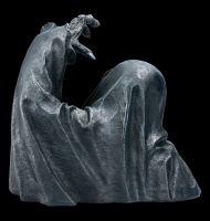 Grim Reaper Figurine rises from Grave