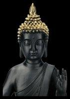 Schwarze Buddha Figur mit erhobener Hand