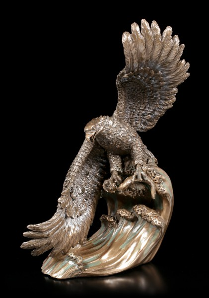 Eagle Figurine snaps Fish out of the Water