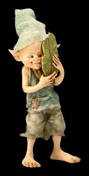 Pixie Kobold Figur versteckt sich hinter Blatt