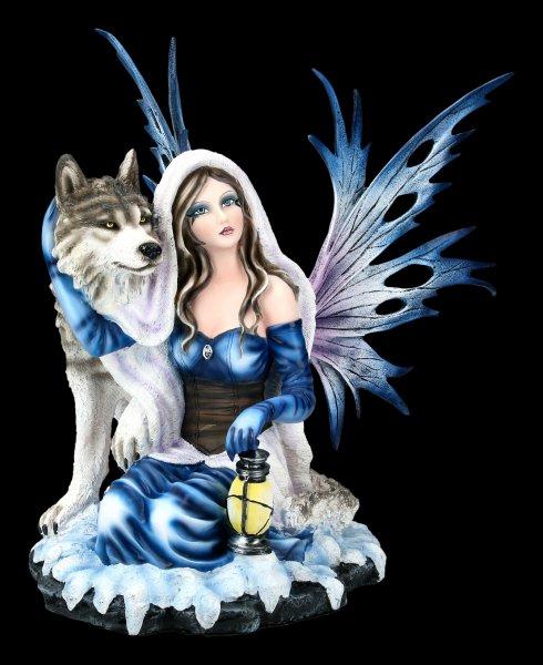 Elfen Figur kniet bei Wolf