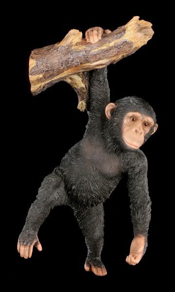 Gartenfigur - Schimpanse am Ast hängend