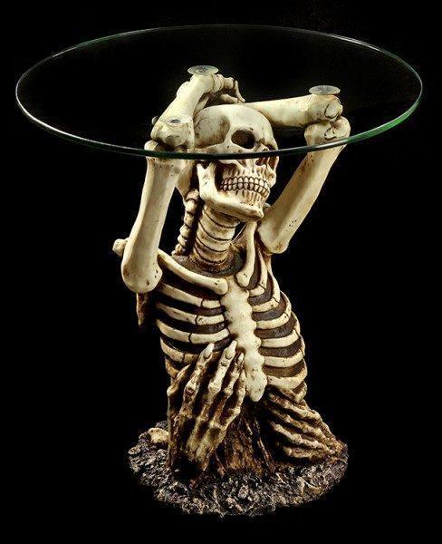 Tisch - Skelett erhebt sich aus Grab