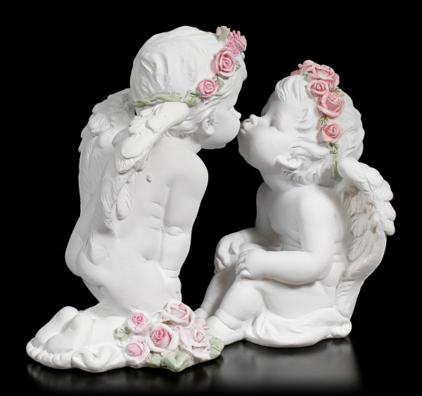 Two white Cherubim Figurines kissing each other